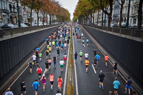 Runners racing through city